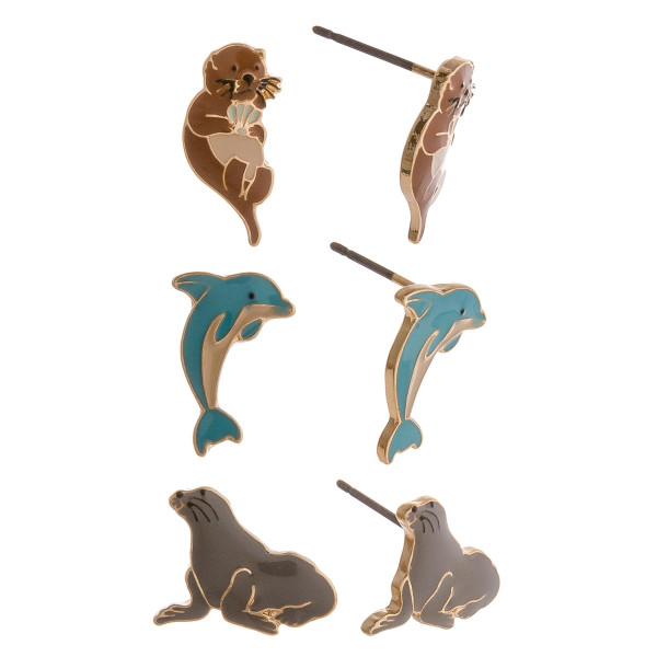 Set of 3 pairs of animal themed stud earrings featuring otters, dolphins, and seals.