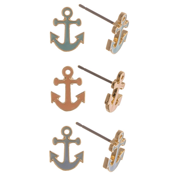 Set of three pairs of stud earrings featuring anchors in mint, peach, and grey.