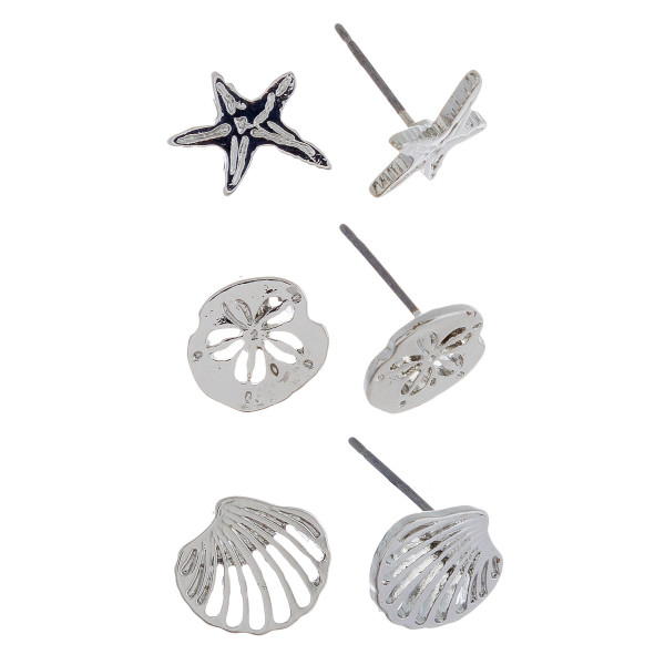 Three-pair stud earrings with starfish, sand dollar, and shell details. Approximate 1cm in length.