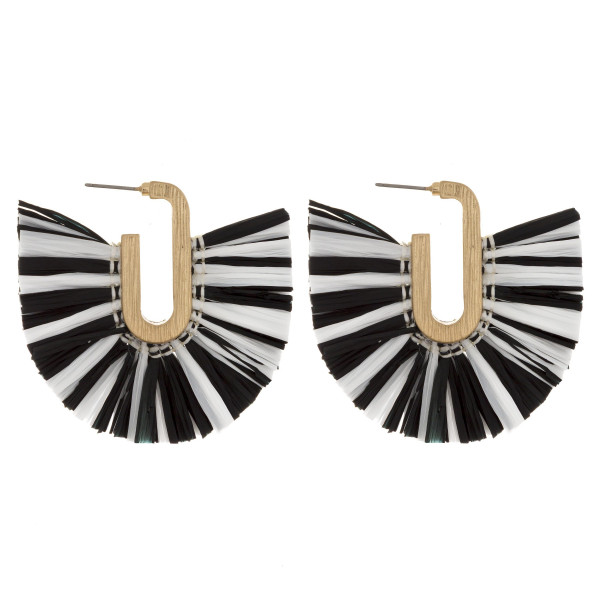 "Long black and white raffia tassel earring. Approximate 2"" in length."