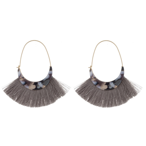 "Long metal earring with acetate and tassel details. Approximate 2.5"" in length."