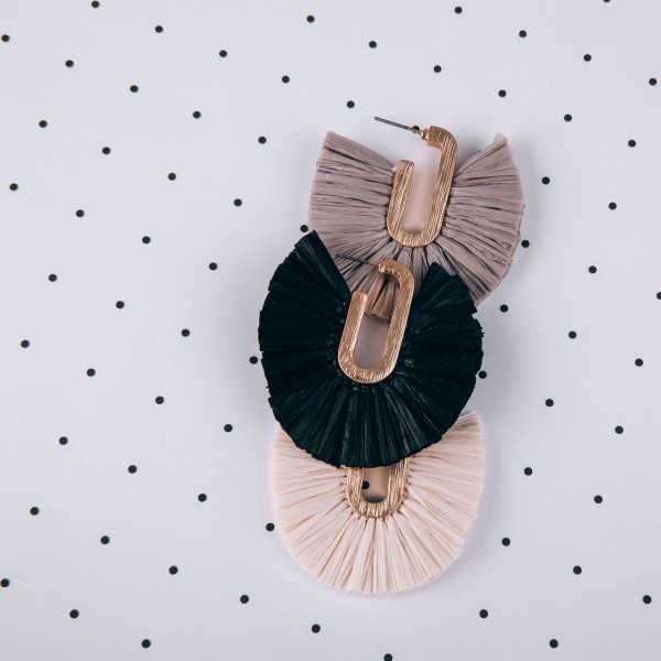 """Long metal earring with raffia fanned tassel. Approximately 2"""" in length"""