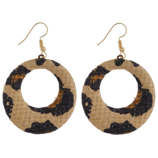 "Circular drop earrings featuring a beige animal print raffia pattern. Approximately 1.5"" in diameter."