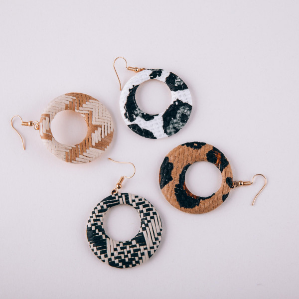 "Circular drop earrings featuring a beige animal print raffia pattern. Approximately 1.5"" in diameter."