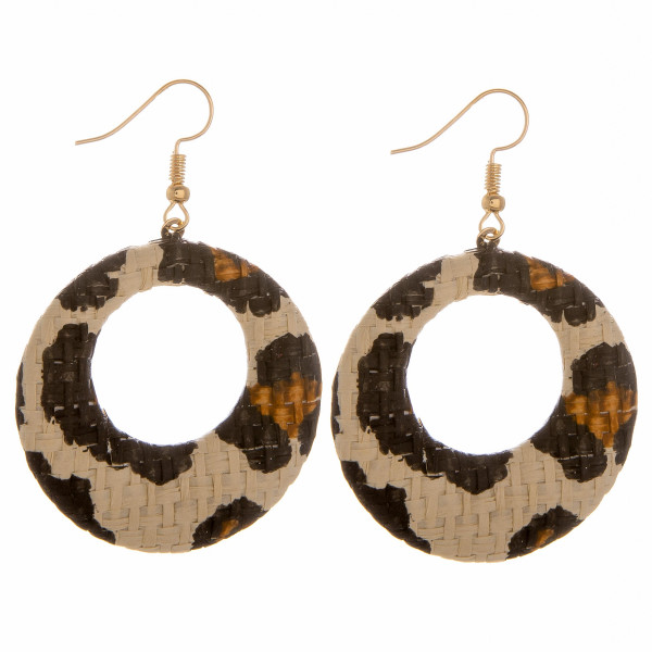 """Circular drop earrings featuring a ivory animal print raffia pattern. Approximately 1.5"""" in diameter."""