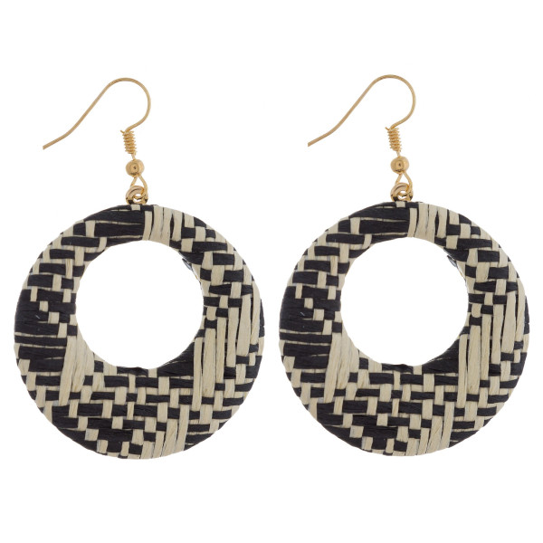 "Circular drop earrings featuring a black and white raffia pattern. Approximately 1.5"" in diameter."