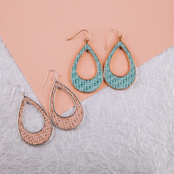 "Long open teardrop earrings with basket weave raffia details. Approximately 2"" long."