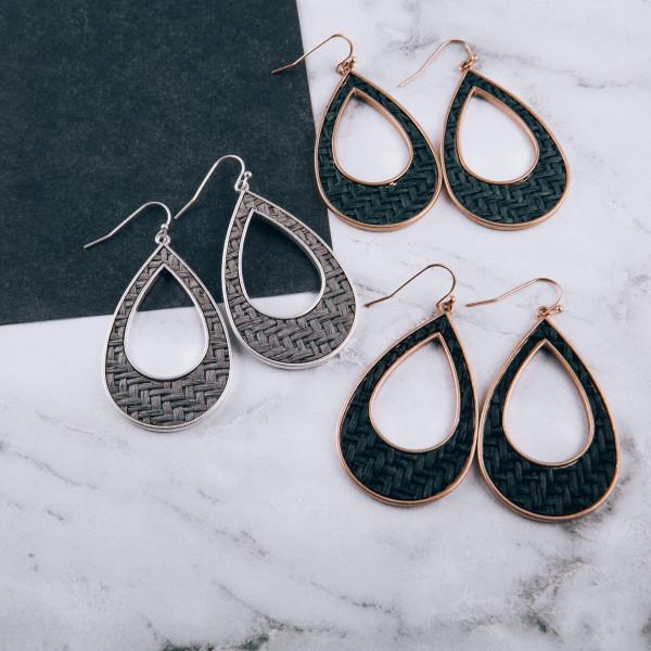 """Long open teardrop earrings with basket weave raffia details. Approximately 2"""" long."""