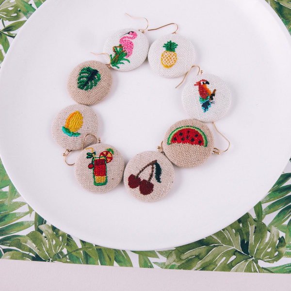 "Raffia circular drop earrings featuring a lemonade embroidered detail. Approximately 1"" in diameter."