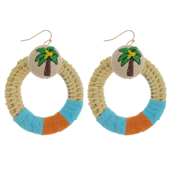 "Large circular raffia wrapped drop earrings featuring a palm tree detail. Approximately 2"" in diameter."