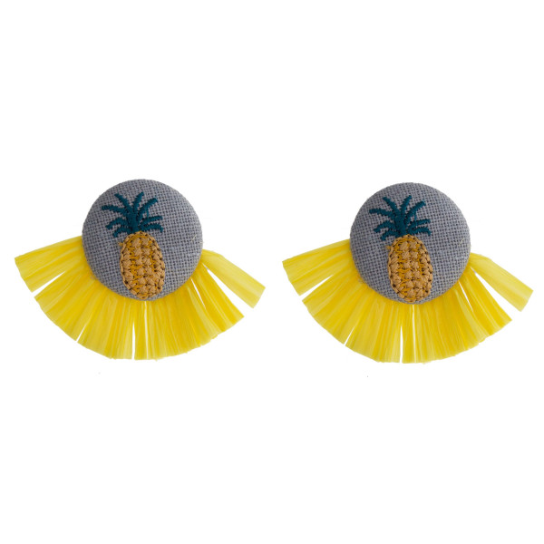 "Yellow raffia tassel earrings featuring a pineapple embroidered detail with a stud post. Approximately 1.5"" in length."