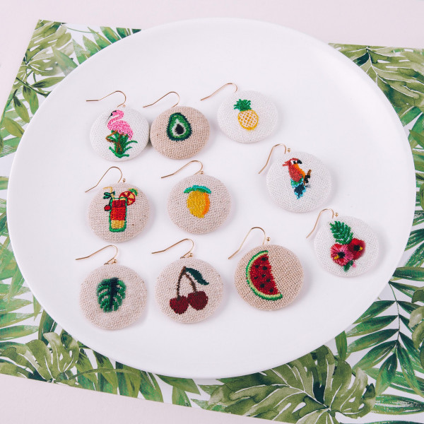 "Raffia circular drop earrings featuring an avocado embroidered detail. Approximately 1"" in diameter."