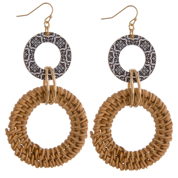 "Rattan woven circular drop earrings featuring a black pattern and gold accents. Approximately 3"" in length."