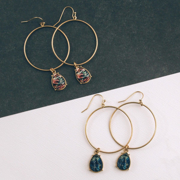 """Circular drop earrings featuring a hanging teardrop wood accent. Approximately 1.5"""" in diameter."""