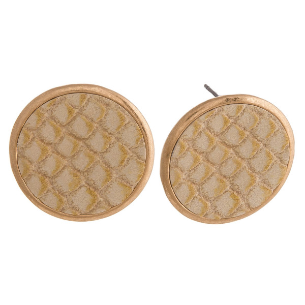 "Circular stud earrings featuring faux leather scale inspired detail. Approximately 1"" in diameter."