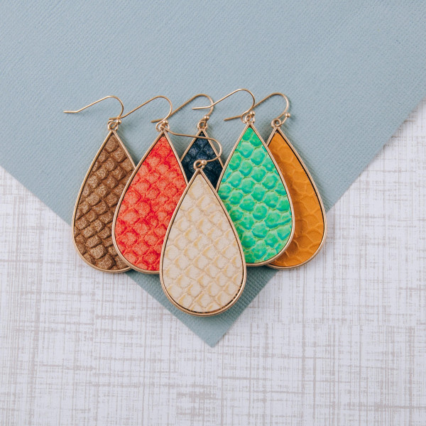 "Teardrop earrings featuring a mermaid scale inspired faux leather centered detail. Approximately 2"" in length."