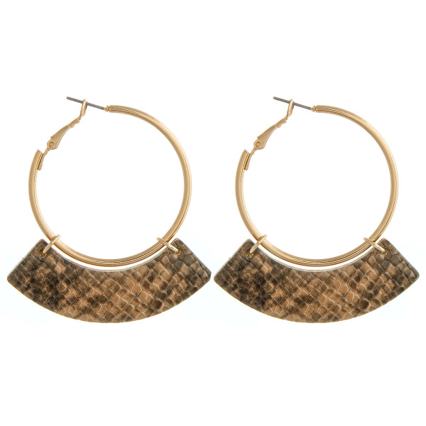 """Gold hoop earrings featuring a faux leather snakeskin accent. Approximately 1.5"""" in diameter. Approximately 2.25"""" in length."""