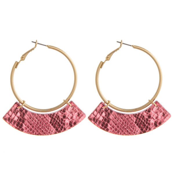 "Gold hoop earrings featuring a faux leather snakeskin accent. Approximately 1.5"" in diameter. Approximately 2.25"" in length."