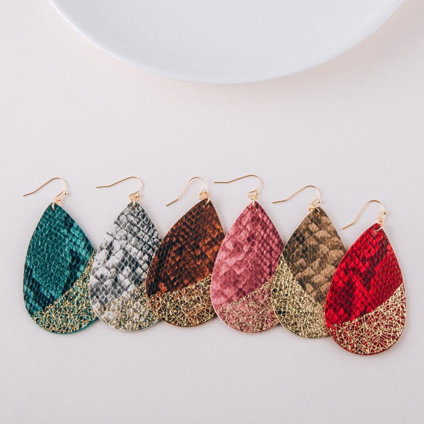 """Faux leather teardrop earrings featuring snakeskin and metallic details. Approximately 2.5"""" in length."""