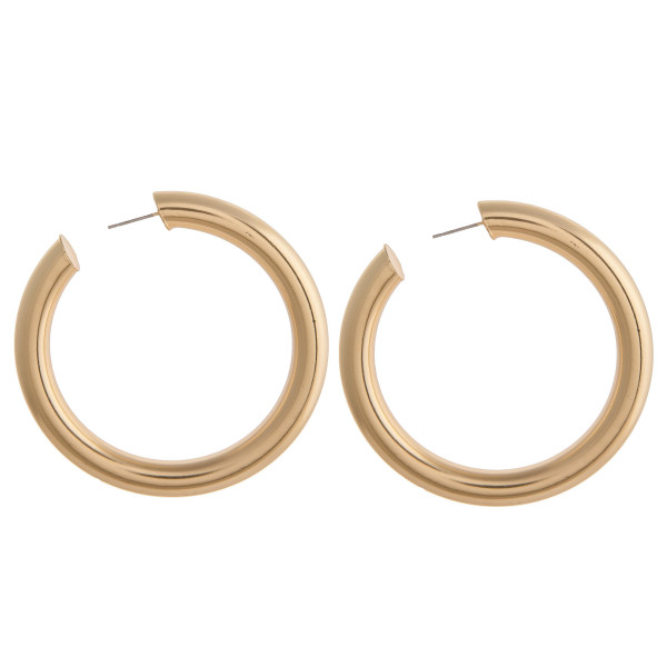 """Extra large open hoop metal earrings with a stud post. Approximately 2.5"""" in diameter."""