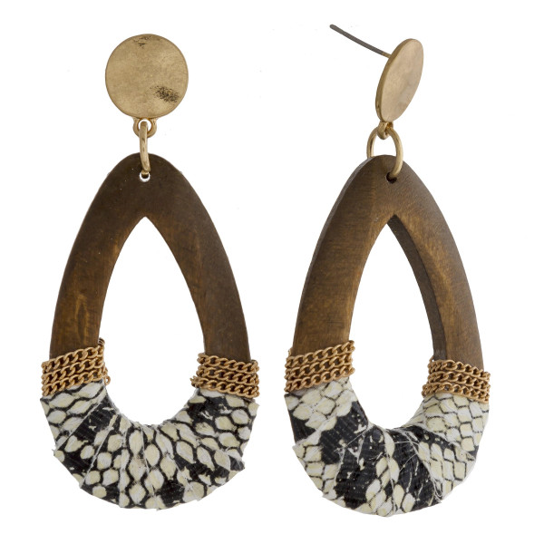 """Wood teardrop earrings featuring faux leather snakeskin and gold details with a stud post. Approximately 2.5"""" in length."""