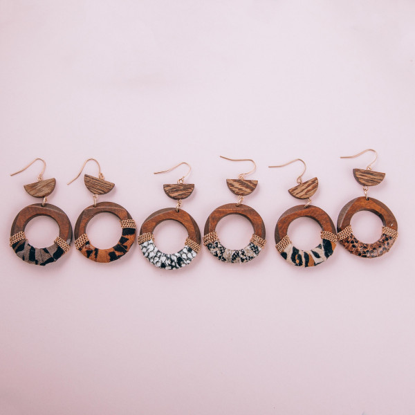 """Long wooden hoop earrings with animal print fabric centered details. Approximate 2.5"""" in length."""