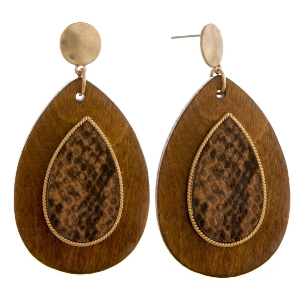"""Long wooden drop earrings with snakeskin raised details. Approximately 2.5"""" in length."""