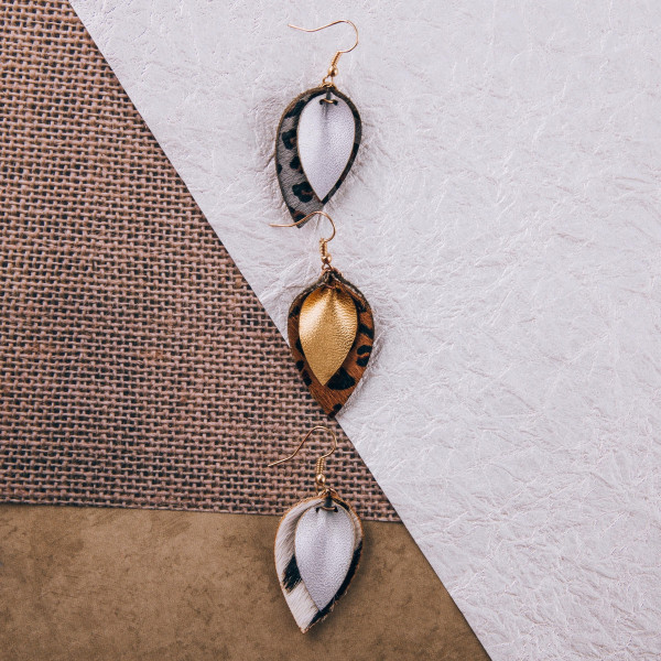 """Genuine leather drop earrings featuring animal print and gold details. Approximately 1.5"""" in length."""
