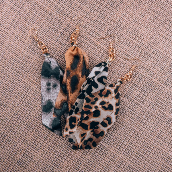 """Long earring with animal printed fabric. Approximate 4"""" in length."""