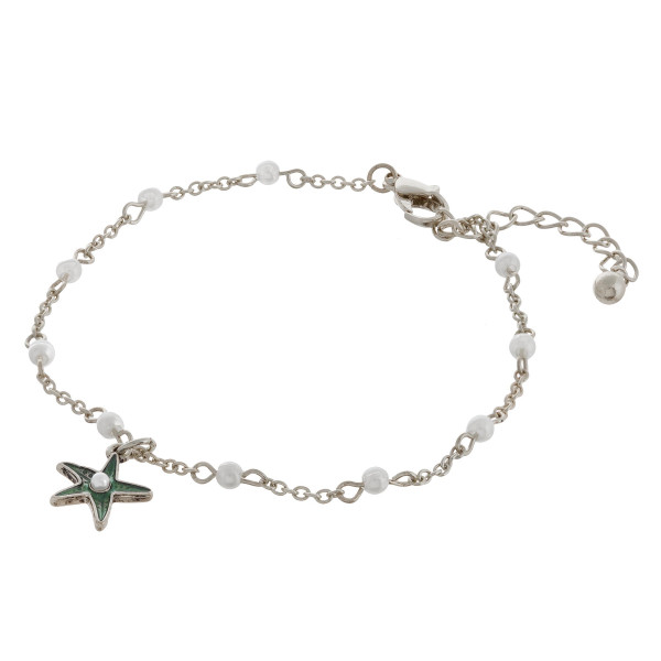 """Metal chain anklet featuring a starfish charm and pearl accents. Approximately 4"""" in diameter with a 2"""" extender."""