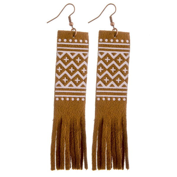 "Faux leather drop earrings featuring a tribal pattern and tassel details. Approximately 3.75"" in length."