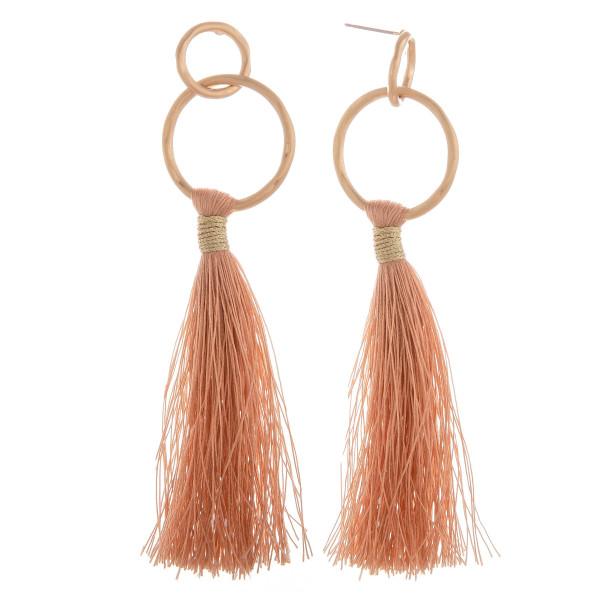 "Long tassel earring with hoop post. Approximate 3.5"" in length."