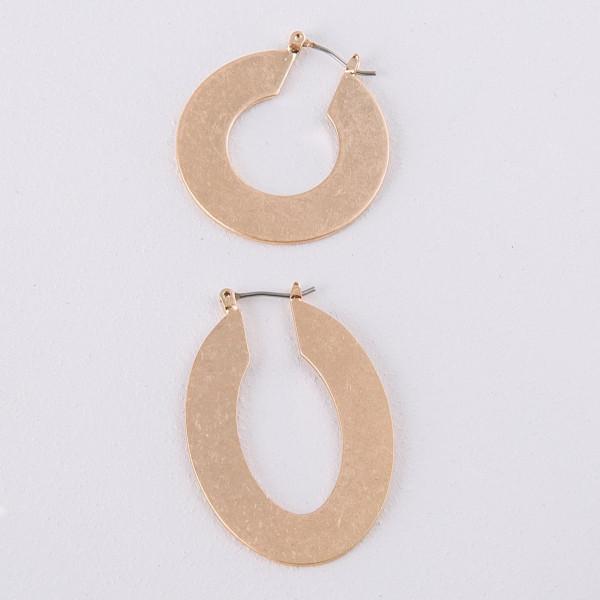 "Thin metal plated circular earrings. Approximately 1"" in diameter."