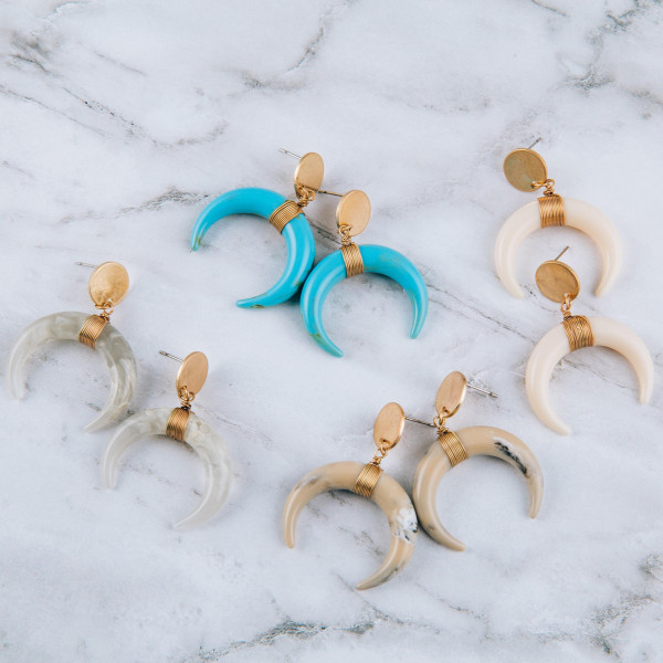 """Crescent earrings with flat gold posts. Measures approximately 1.5"""" in length."""