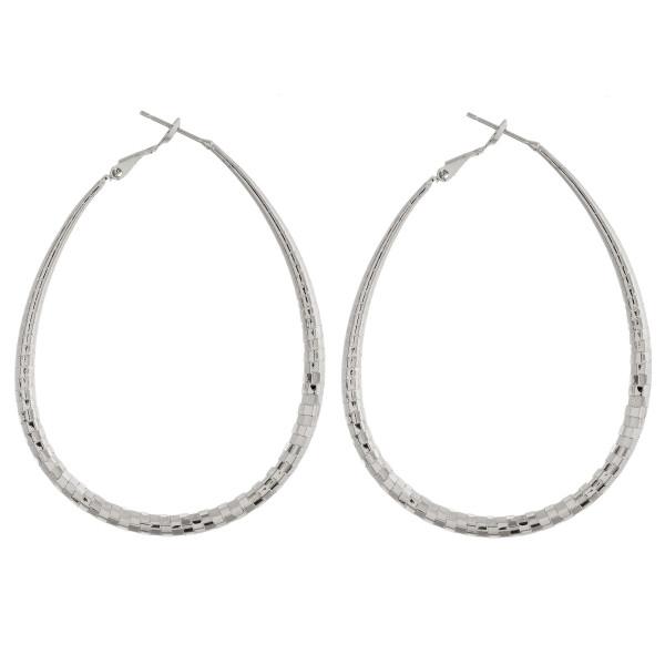 "Large drop metal earrings. Approximate 2.5"" in length."
