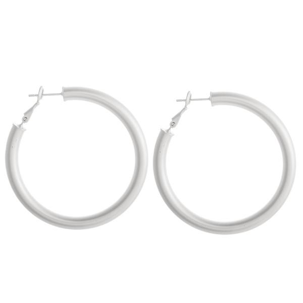 """Silver hoop earrings. Measure approximately 2"""" in diameter."""