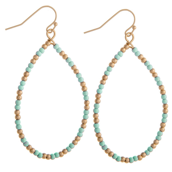 """Mint beaded teardrop earrings featuring gold accents. Measures approximately 2"""" in diameter."""