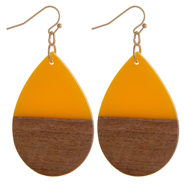 """Teardrop earrings featuring yellow resin and wood accents. Approximately 1.5"""" in length."""