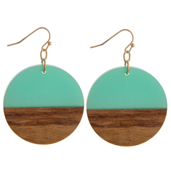 """Circular drop earrings featuring wood and resin accents. Measures approximately 1.5"""" in diameter."""
