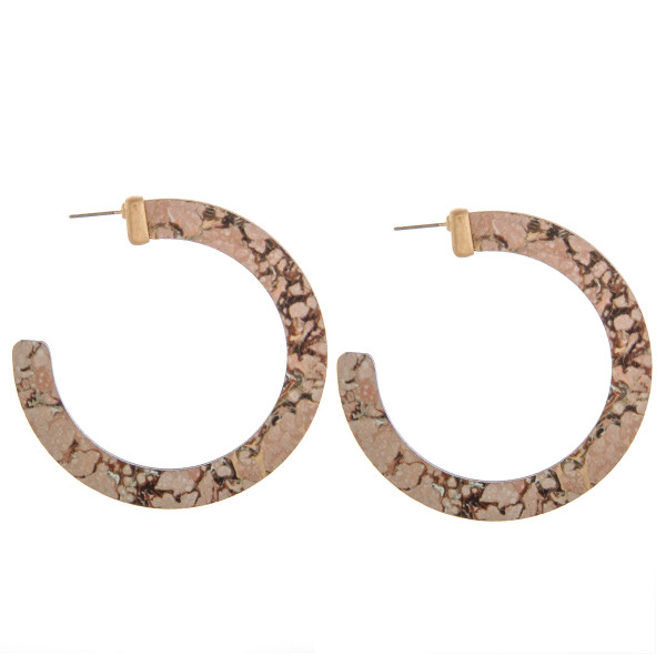 "Wood hoop earrings featuring a fire quartz inspired pattern. Measure approximately 2.5"" in diameter."