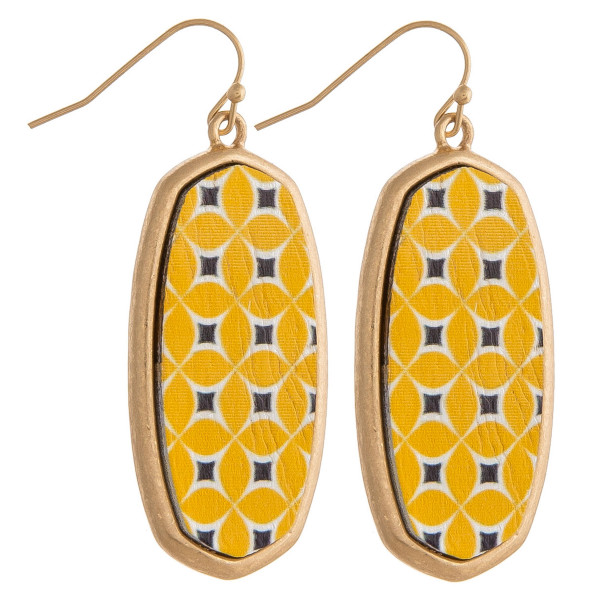 "Long metal earrings featuring a wood colored center detail. Approximately 1.5"" in length."