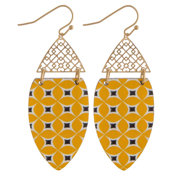 "Long drop earrings featuring a filigree inspired pattern and a wood colored accent. Approximately 2"" in length."