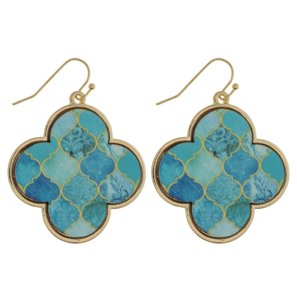 "Clover inspired drop metal earrings featuring a wood centered detail. Approximately 1.5"" in length."
