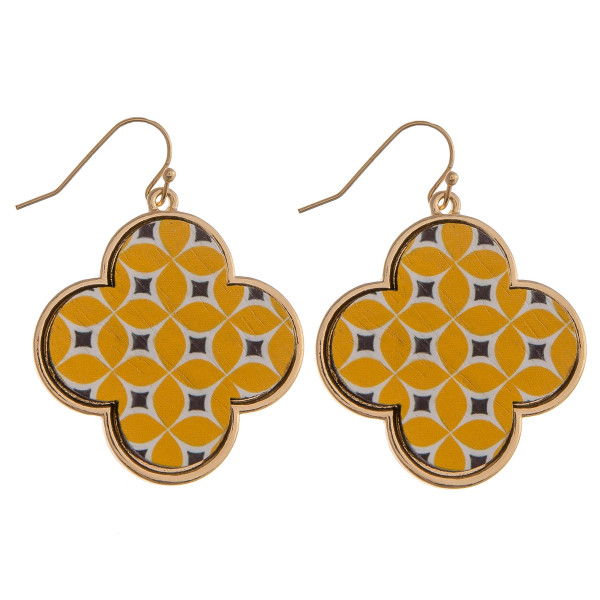 "Wood quatrefoil drop earrings featuring a yellow pattern. Approximately 1.5"" in length."