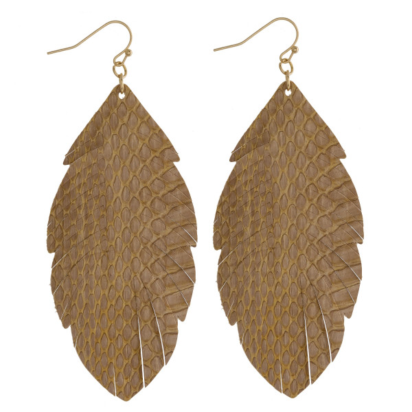 "Faux leather feather inspired drop earrings featuring beige alligator skin. Approximately 3"" in length."