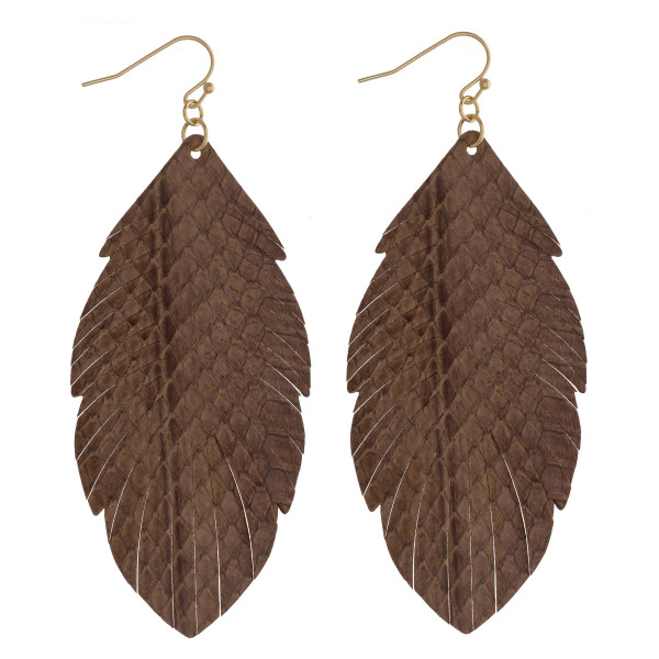"Faux leather feather inspired drop earrings featuring brown alligator skin. Approximately 3"" in length."