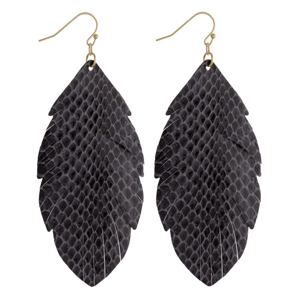 "Faux leather feather inspired drop earrings featuring grey alligator skin. Approximately 3"" in length."