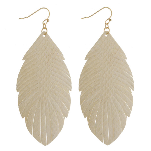 "Faux leather feather inspired drop earrings featuring ivory alligator skin. Approximately 3"" in length."