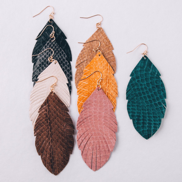 """Faux leather feather inspired drop earrings featuring light pink alligator skin. Approximately 3"""" in length."""