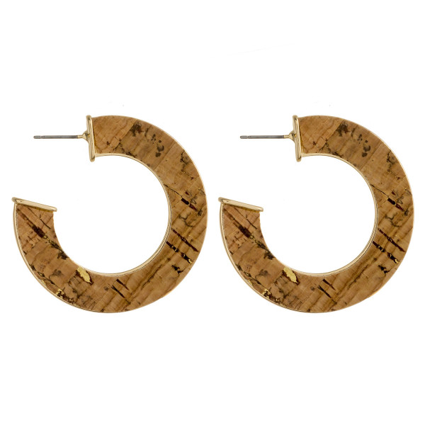"""Metal hoop earrings featuring cork inspired details and a stud post. Approximately 1.5"""" in diameter."""